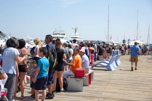 A summer crowd enjoying the HarborWalk