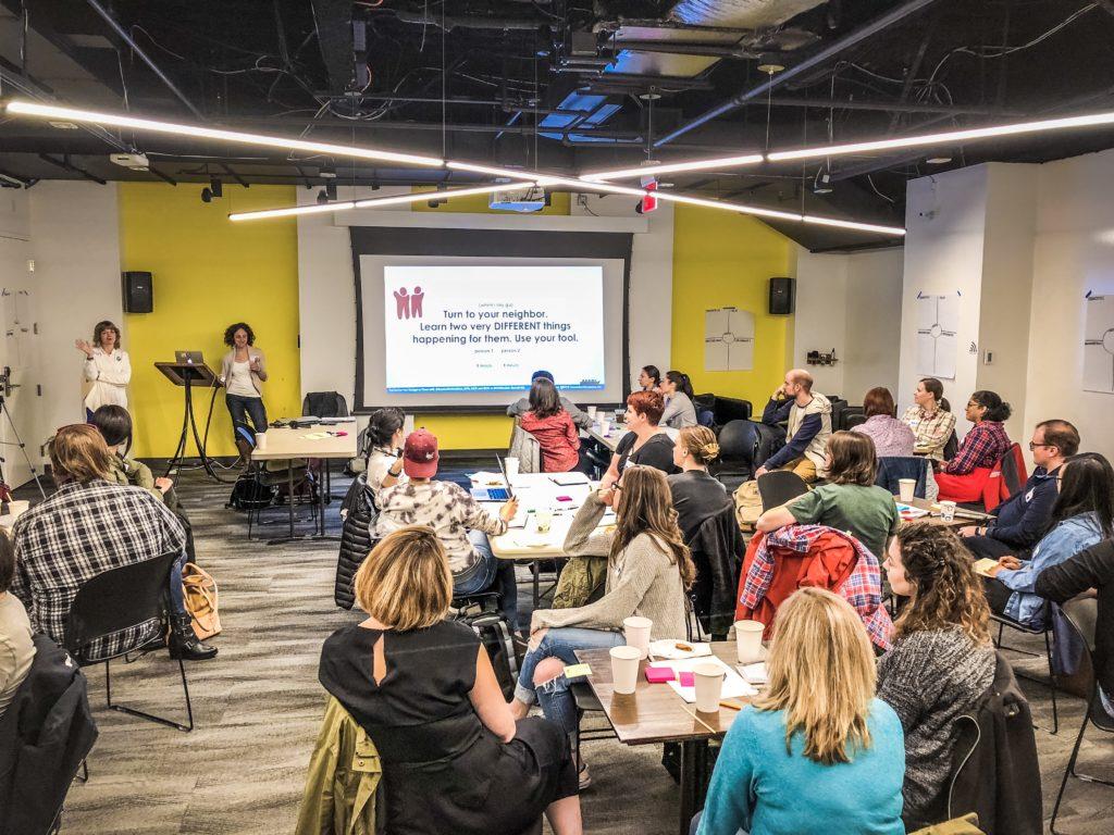 Ela Ben-Ur presents the Innovators' Compass to the Design-a-thon teams
